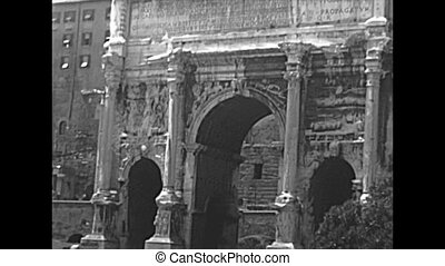 Close up of Settimio Severo arch and Historical Senatorio palace, the Campidoglio of Rome by the Roman Forum. BW archival of Rome capital of Italy in the 1960s