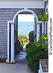 A view to the ocean through an archway in Provincetown, Massachusetts.
