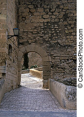 An arch way in a castle in Spain