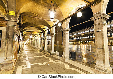 Archway at night in St Marco square, Venice, Italy.