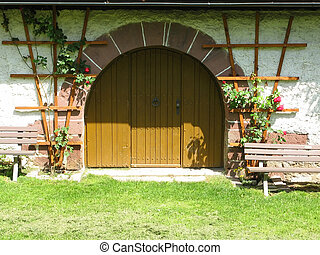 this image shows a medieval archway with door