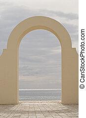 Archway on an Italian beach.