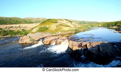 Arctic falls the river in tundra summer - cascade on the...
