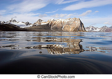 Arctic fjord - reflection in water - Spitsbergen, Svalbard -...