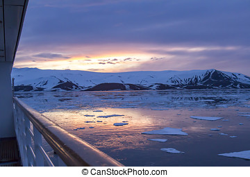 Arctic Glow reflecting in Whalers Bay, Deception Island, Antarctica with cruise deck