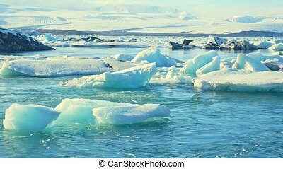 Norway ice background of mountain on water of arctic ocean. Wildlife in footage on natural landscape and snow and glacier water texture