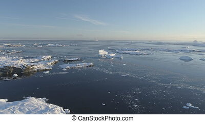 Arctic Polar Open Water Glacier Aerial View. Ice Melt in Winter Ocean Water Surface Flight Drone Above Overview. Antarctica Climate Change Concept Footage Shot in 4K (UHD)