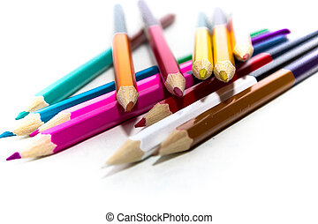 are scattered colored pencils