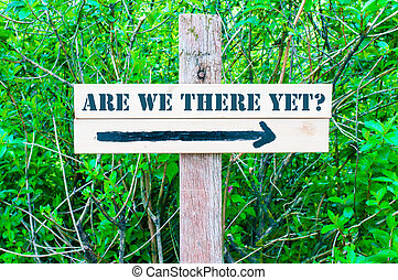 ARE WE THERE YET Directional sign - ARE WE THERE YET written...