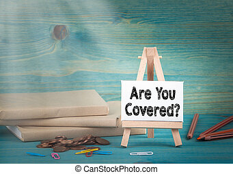 Are You Covered. business concept. notice board by the books and money, and notifications