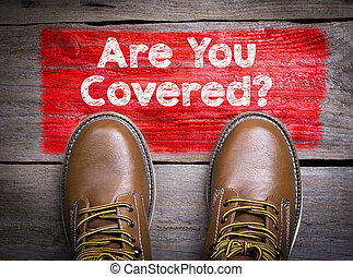 Are You Covered. Top View of Boot on wooden background