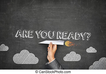 Are you ready concept on black blackboard with businessman...