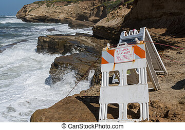 Area Close Signs on Cabrillo Coast during unusually high ...