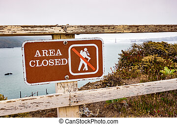 Area Closed sign posted on the Pacific Ocean coast in Marin ...