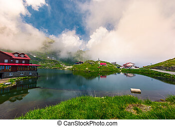 area of lake Balea in clouds. Gorgeous summer landscape of...