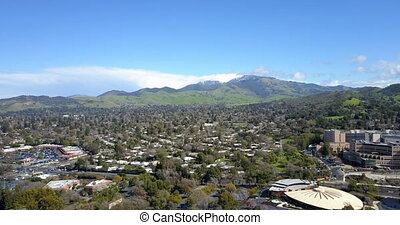 Areal view of Walnut Creek with peaks of Mount Diablo at...
