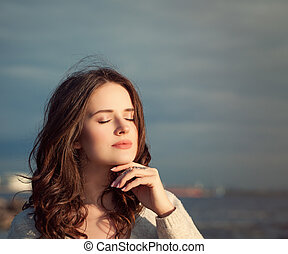 arefree Girl Outdoor. Beautiful Model Woman on Blue Sky and Ocean Background