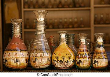 areia, garrafas