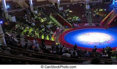 Arena is empty, spectators sit down on the places before the...