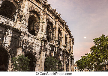 Arena of Nimes at sunrise and moonset
