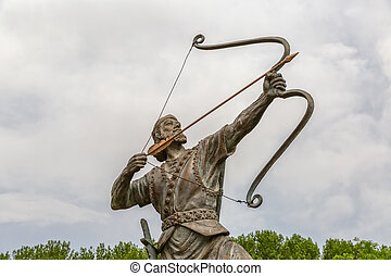 Aresh the Archer tightens arrow - Statue of Aresh Kamangir...