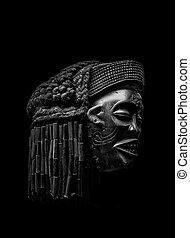 Arfican Head Sculpture on Black Background