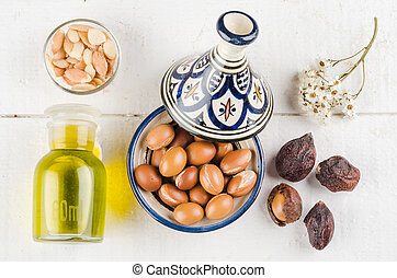 Argan fruit in a moroccan tajine - Argan Fruit on a wooden...