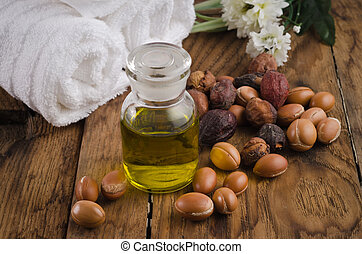 Argan fruits and glass bottle of Ar