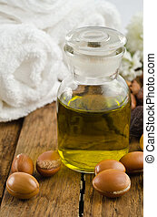 Argan fruits and glass bottle of Ar - Classic glass bottle...