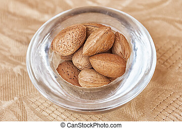 Argan nuts in a glass cup.