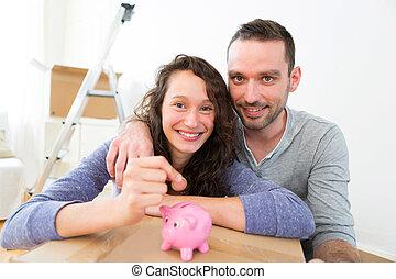 argent économie, couple, jeune, tirelire