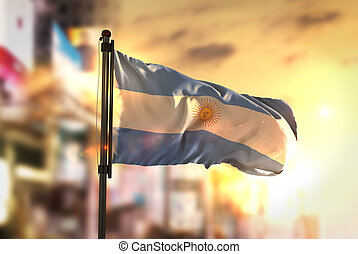 Argentina Flag Against City Blurred Background At Sunrise Backlight