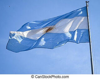 Argentina flag on a pole, with the Inca sun in the middle.