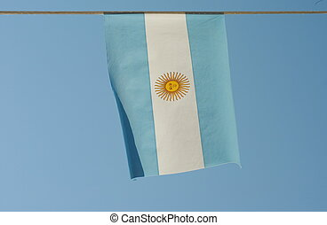 argentina flag waves in a blue sky