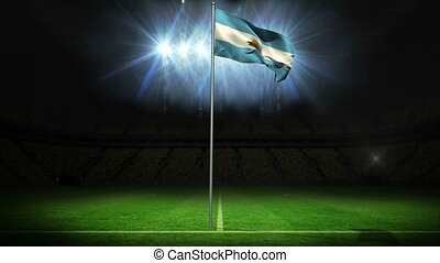 Argentina national flag waving on flagpole against football...
