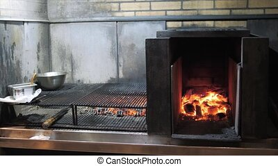 Argentine grill. Fire and grill preparation for barbecue at...