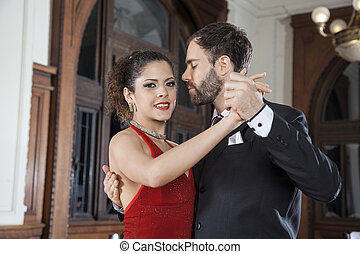 Argentine Tango Dancer Performing Gentle Embrace Step With Partner