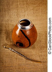 Argentinean Calabash with Bombilla over canvas background, ...