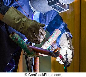 Argon welding - Worker welded iron pipe by argon welding ...