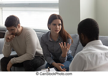 Argue woman with man at reception with family therapist.