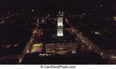Arial city Lviv, Ukraine Rynok square, Town Hall, Christmas Fair, People skate on ice skating rink