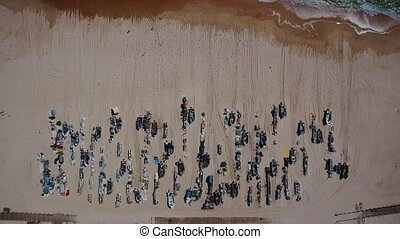Arial. Fishing boats and tackles on the beach of Monte Gordo. View from the sky.