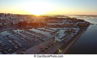 Arial. Sunset over the Portuguese tourist city of Faro, view...