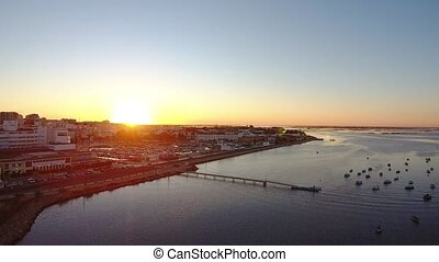 Arial. Sunset over the Portuguese tourist city of Faro, view of the dock.
