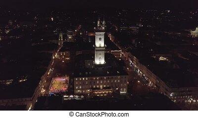 Arial view of city Lviv, Ukraine Rynok square, Christmas Fair, people skate on ice skating rink