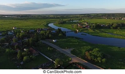 Arial view over small village. View of the river and green...