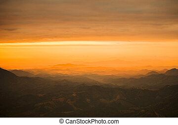 Arid land top view sunset over view on hill with agriculture mountain destroy the forest