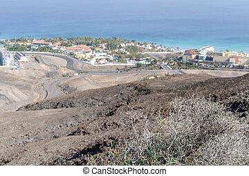 Arid landscape of Fuerteventura with resorts on the coast