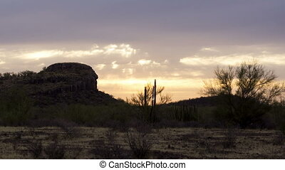 Arid Mountain Day to Red Sunset Tim - Timelapse of daytime...