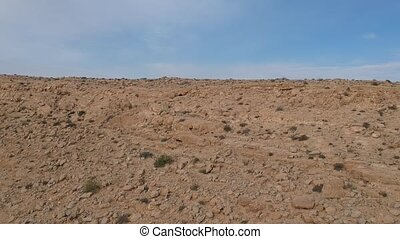 Ariel view of a ridge of desert soil - Fly over drone shot...